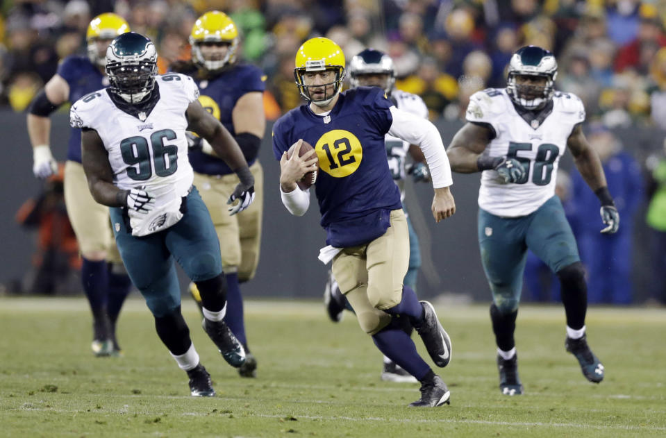 Green Bay Packers' Aaron Rodgers runs for a first down during the first half of an NFL football game against the Philadelphia Eagles Sunday, Nov. 16, 2014, in Green Bay, Wis. (AP Photo/Tom Lynn)