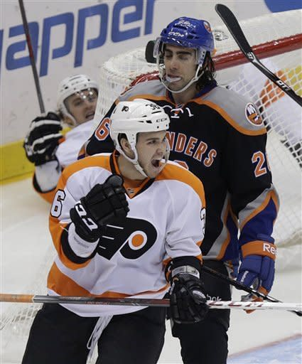 Philadelphia Flyers' Zac Rinaldo, bottom, celebrates his goal while New York Islanders' Matt Moulson reacts during the third period of an NHL hockey game Monday, Feb. 18, 2013, in Uniondale, N.Y. The Flyers beat the Islanders 7-0. (AP Photo/Seth Wenig)