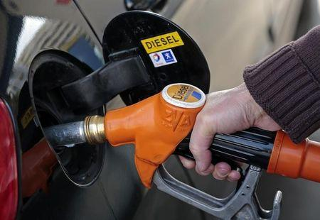 A customer fills-up his car with diesel at a gas station in Nice