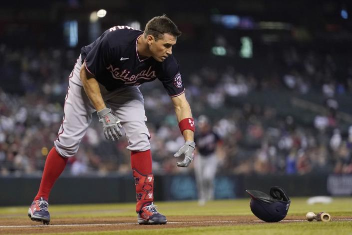 Washington Nationals' Ryan Zimmerman tosses his helmet down after striking out against the Arizona Diamondbacks during the first inning of a baseball game Sunday, May 16, 2021, in Phoenix. (AP Photo/Ross D. Franklin)