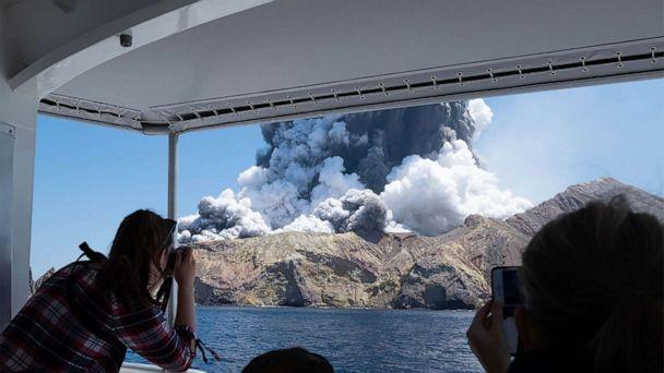 PHOTO: This handout photo courtesy of Michael Schade shows the volcano on New Zealand's White Island spewing steam and ash moments after it erupted on Dec. 9, 2019. (Handout/Michael Schade/AFP via Getty Images)
