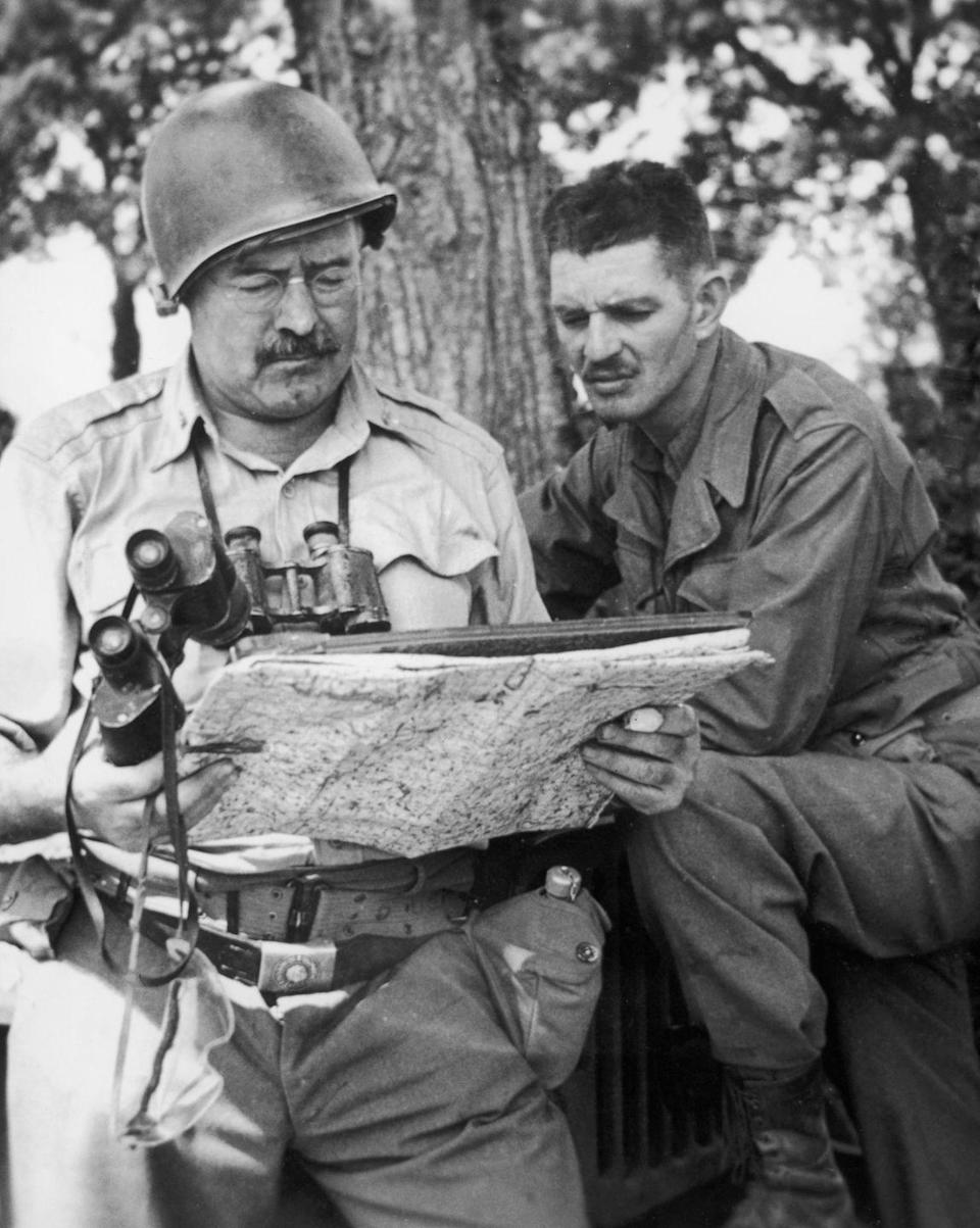 """<p>Hemingway traveled to Europe once again in 1944 as a war correspondent, <a href=""""https://www.archives.gov/publications/prologue/2006/spring/hemingway.html"""" rel=""""nofollow noopener"""" target=""""_blank"""" data-ylk=""""slk:this time for World War II"""" class=""""link rapid-noclick-resp"""">this time for World War II</a>. As a journalist, he traveled with United States troops throughout Europe. </p>"""
