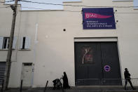 A banner announces the BIAC, International Circus Arts Biennale, that will take place behind closed doors at the Archaos Circus compagnie theater in Marseille, south of France, Thursday, Feb. 4, 2021. The fourth edition of the global Circus Biennale is demonstrating how the performing arts have a way of flourishing in between the cracks, celebrating the death-defying and spine stretching arts that go behind the storied spectacle. (AP Photo/Francois Mori)