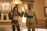 """Teyana Taylor, left, and Wesley Snipes appear in a scene from """"Coming 2 America."""" (Quantrell D. Colbert/Paramount Pictures via AP)"""