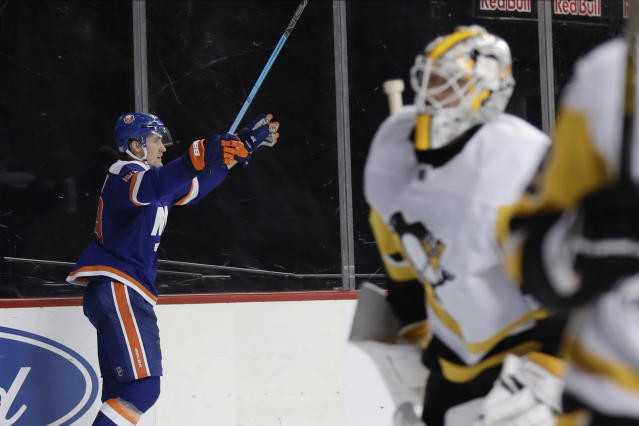 New York Islanders' Brock Nelson (29) celebrates after scoring a goal during the overtime period of an NHL hockey game against the Pittsburgh Penguins Thursday, Nov. 21, 2019, in New York. The Islanders won 4-3. (AP Photo/Frank Franklin II)