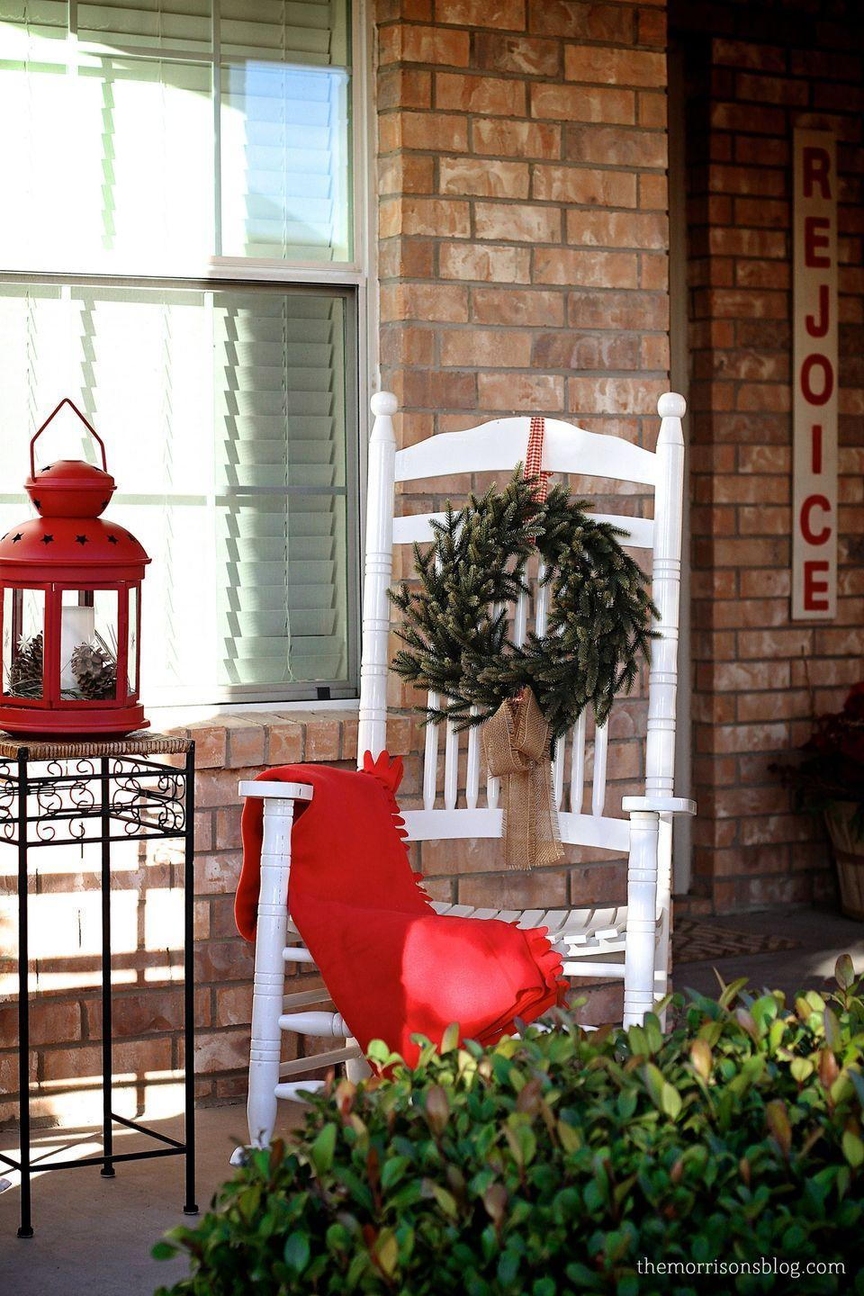 """<p>The weather outside may be frightful. But there's nothing cozier than rocking away on a magically decorated porch during the holiday season. Hang woolen blankets over your rocking chairs to get the full effect and keep your guests warm. Or try giving each rocker its own wreath.<br></p><p><strong><em>Get the look at <a href=""""http://themorrisonsblog.com/christmas-home-tour-2013/"""" rel=""""nofollow noopener"""" target=""""_blank"""" data-ylk=""""slk:This Boy Mom"""" class=""""link rapid-noclick-resp"""">This Boy Mom</a>.</em></strong></p>"""