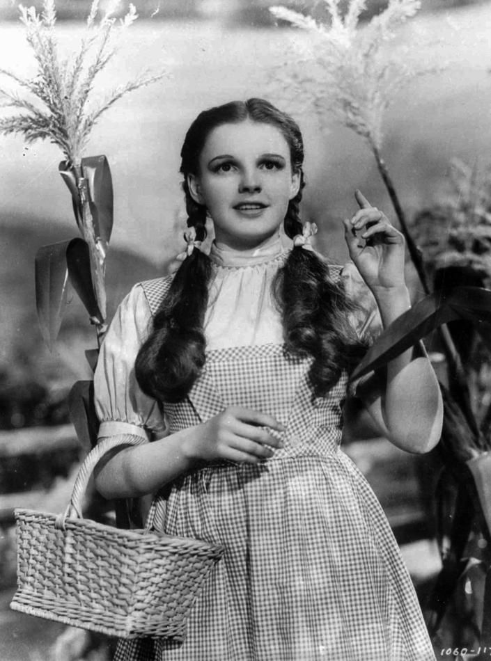 """FILE - In this 1939 file photo provided by Warner Bros., Judy Garland portrays Dorothy in a scene from """"The Wizard of Oz."""" Garland's original costume from """"The Wizard of Oz"""" will be up for sale at Julien's Auctions in November 2012. (AP Photo/Warner Bros., file)"""