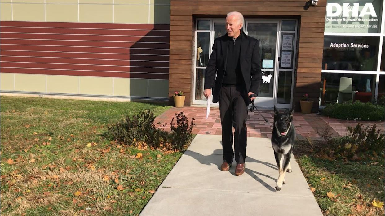 Joe Biden walks out of the Delaware Humane Association with his canine pal Major. (Photo: Steph Gomez via Delaware Humane Association)