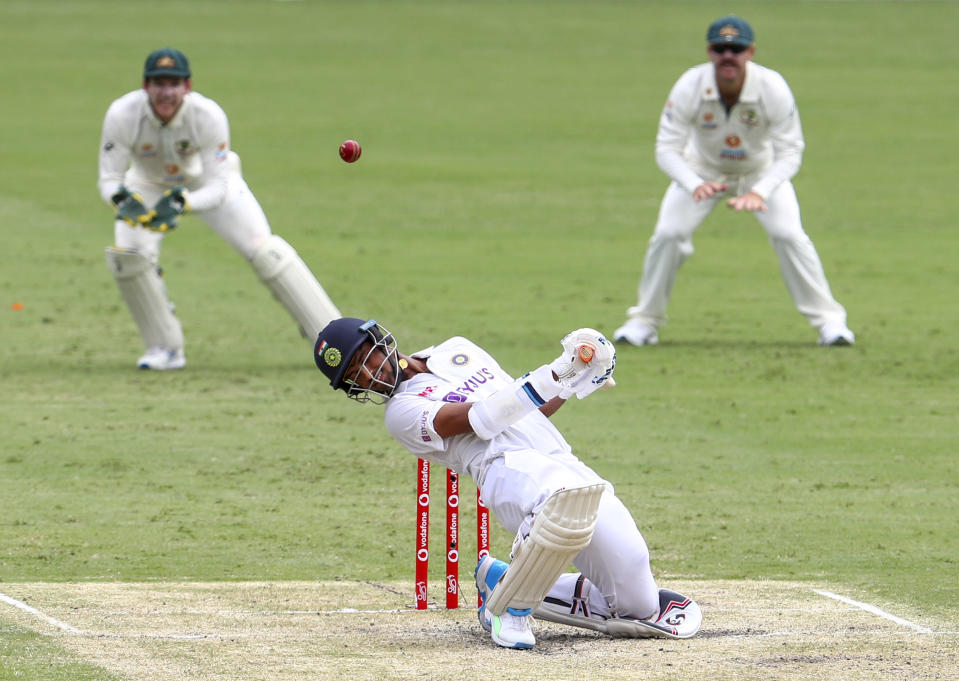India's Washington Sundar ducks to avoid a bouncer during play on day three of the fourth cricket test between India and Australia at the Gabba, Brisbane, Australia, Sunday, Jan. 17, 2021. (AP Photo/Tertius Pickard)
