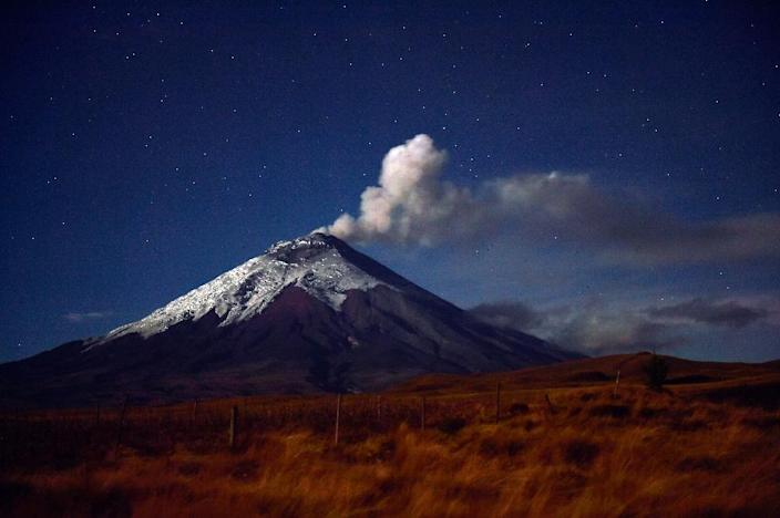 Cotopaxi, whose snowy peak rises majestically from the patchwork quilt of central Ecuador's high plains, rumbled to life on August 14, belching a column of ash in its first major eruption since 1877 (AFP Photo/Rodrigo Buendia)