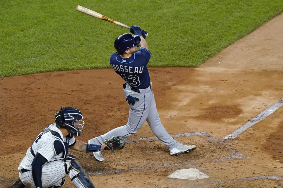 Tampa Bay Rays Michael Brosseau follows through on a solo home run, his second of the night, during the fourth inning of a baseball game against the New York Yankees, Wednesday, Sept. 2, 2020, at Yankee Stadium in New York. Yankees catcher Gary Sanchez is behind the plate. (AP Photo/Kathy Willens)