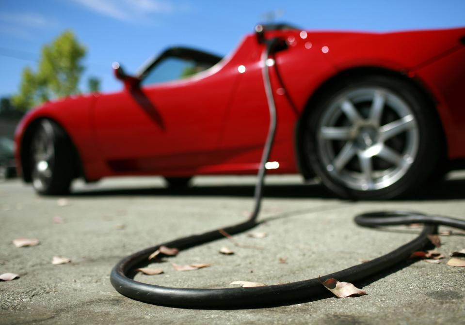 A Tesla Roadster is electrically charged at Tesla Motors Inc in San Carlos, California July 22, 2009. TESLA/ REUTERS/Robert Galbraith