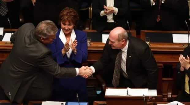 Clark, second from left, is flanked by then-energy and mines minister Rich Coleman, left, and then-finance minister Mike de Jong on budget day at the B.C. Legislature in Victoria on Feb. 16, 2016.
