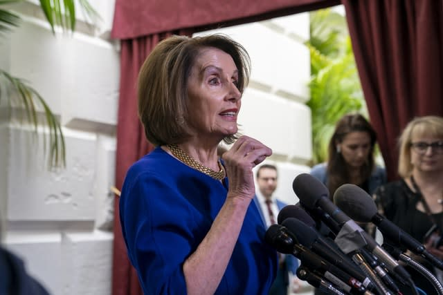 Nancy Pelosi responds to reporters as she departs after meeting with House Democrats