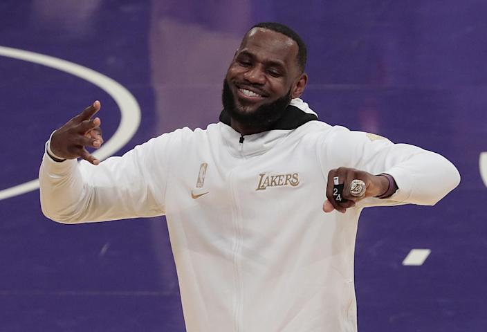 Lakers forward LeBron James enjoys the moment after receiving his championship ring Dec. 22 at Staples Center.