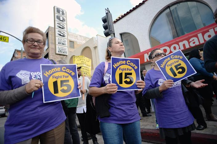 Home healthcare workers join fast food workers and their supporters at a rally and march to demand an increase of the minimum wage, in Los Angeles on December 4, 2014 (AFP Photo/Robyn Beck)