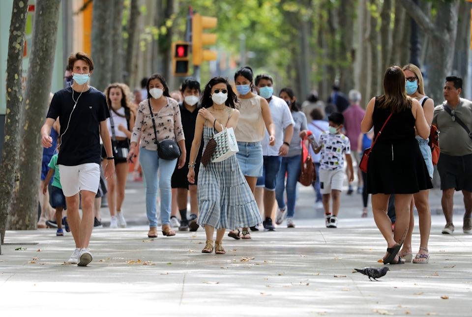 People walk in Barcelona on June 26, 2021. - From June 26, Spanish government has removed the mandatory use of masks in outdoor areas. (Photo by Joan Valls/Urbanandsport/NurPhoto via Getty Images)