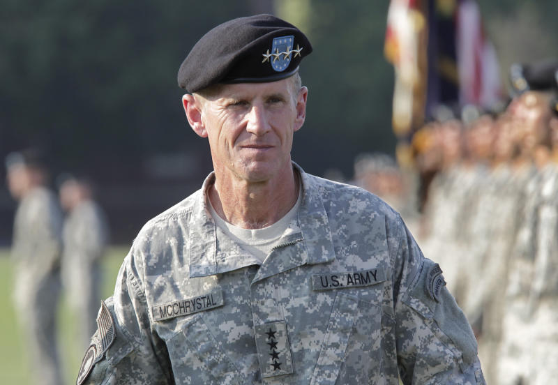 """FILE - This July 23, 2010 file photo shows Gen. Stanley McChrystal reviewing troops for the last time as he is honored at a retirement ceremony at Fort McNair in Washington. A memoir by retired Gen. Stanley McChrystal has been delayed pending security clearance from the U.S. Department of Defense. Portfolio announced Wednesday that McChrystal's """"My Share of the Task"""" is still being reviewed by the Pentagon. McChrystal is the former commander of U.S. troops in Afghanistan.  (AP Photo/J. Scott Applewhite, file)"""