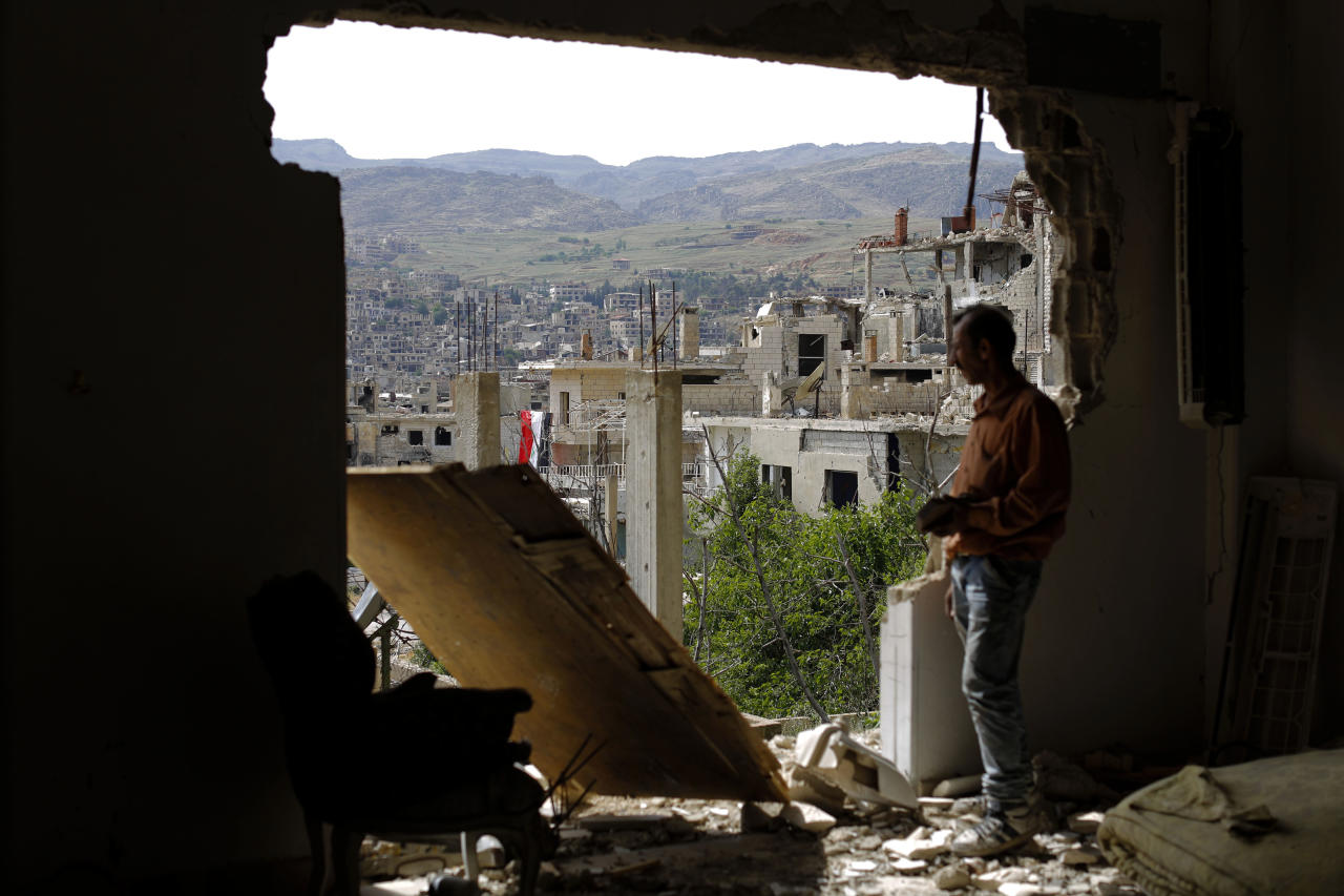 A man checks the damage at the mountain resort town of Zabadani in the Damascus countryside, Syria, Thursday, May 18, 2017.(AP Photo/Hassan Ammar)