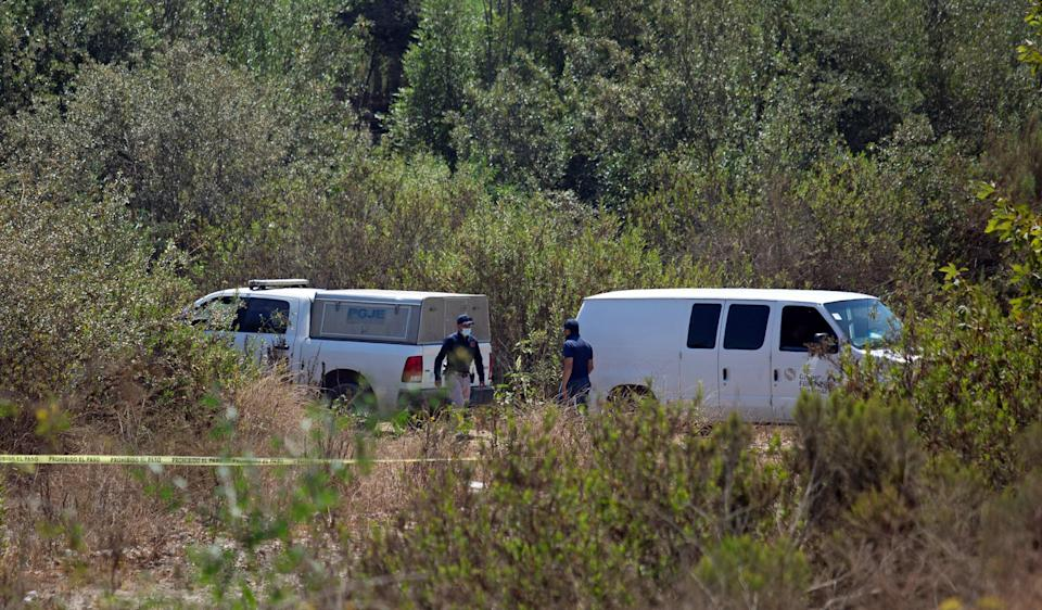 Image: Forensic technicians work at the scene where two American children were found dead in Rosarito (Reuters)