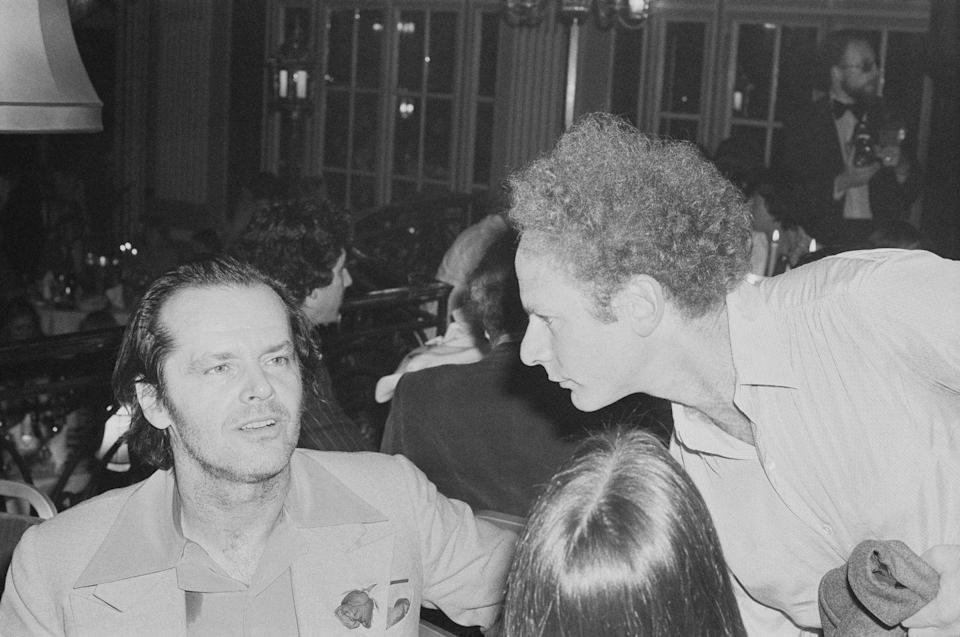 <p>Jack Nicholson and Art Garfunkel chatting at a party in the U.K. on September 22, 1978.</p>