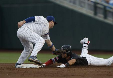 Jun 21, 2018; Omaha, NE, USA; Florida Gators second baseman Blake Reese (12) tags out Texas Tech Red Raiders second baseman Brian Klein (5) in the third inning in the College World Series at TD Ameritrade Park. Mandatory Credit: Bruce Thorson-USA TODAY Sports