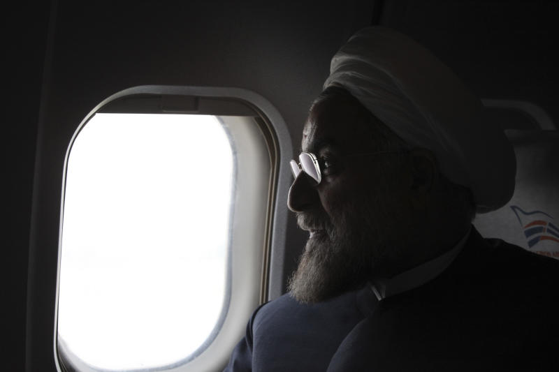 FILE - In this Monday, June 10, 2013 file photo, Iranian presidential candidate Hasan Rowhani, a former Iranian nuclear negotiator, looks on, in his plane, during a campaign tour, in northwestern, Iran. American officials are hailing the election of President-elect Rowhani who vows to seek relief from international sanctions as the first tangible evidence that the U.S. strategy is affecting Tehran's nuclear policy after wreaking havoc on its economy. The draconian sanctions weighed heavily in the June 14 vote for Rowhani, a candidate who openly criticized how his country's leadership has handled the nuclear file. (AP Photo/Vahid Salemi, File)