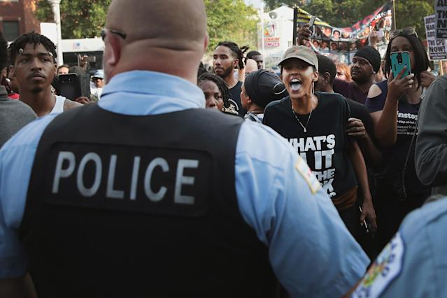 <p>Demonstrators in the South Shore neighborhood protesting the shooting death of 37-year-old Harith Augustus have a heated exchange with police on July 15, 2018 in Chicago, Ill. (Photo: Scott Olson/Getty Images) </p>