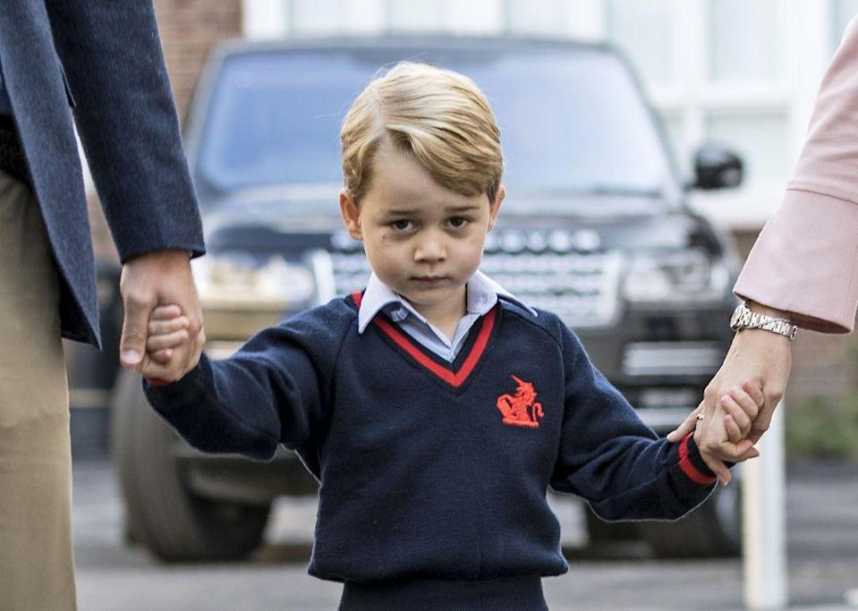"""<p>The eldest Cambridge child looked nervous as he joined his father Prince William for his <a href=""""https://www.elle.com/uk/life-and-culture/culture/news/a38307/prince-george-first-day-school-thomas-battersea/"""" rel=""""nofollow noopener"""" target=""""_blank"""" data-ylk=""""slk:first day of school"""" class=""""link rapid-noclick-resp"""">first day of school</a> at Thomas's Battersea in September 2017.</p>"""