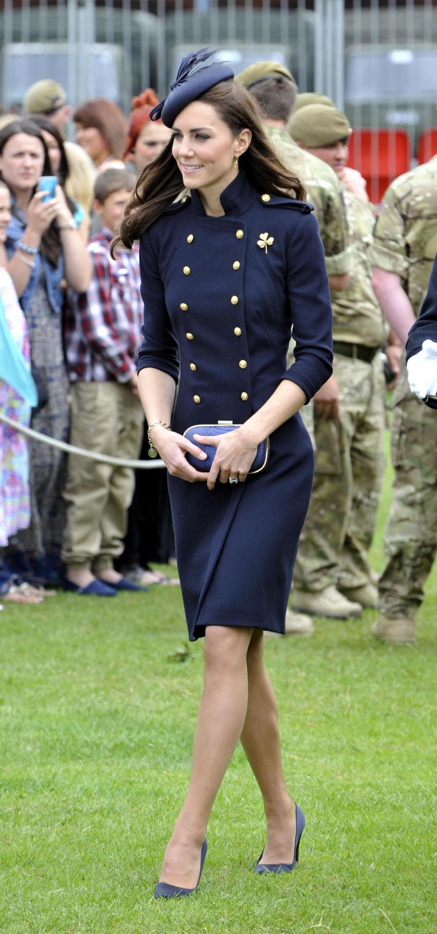 <p>For a military service, Kate donned a navy Alexander McQueen coat with a matching hat and Anya Hindmarch box clutch. </p><p><i>[Photo: PA]</i></p>