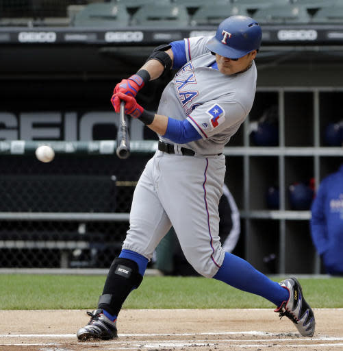 Texas Rangers' Shin-Soo Choo, of South Korea, hits a single against the Chicago White Sox during the first inning of a baseball game Sunday, May 20, 2018, in Chicago. (AP Photo/Nam Y. Huh)
