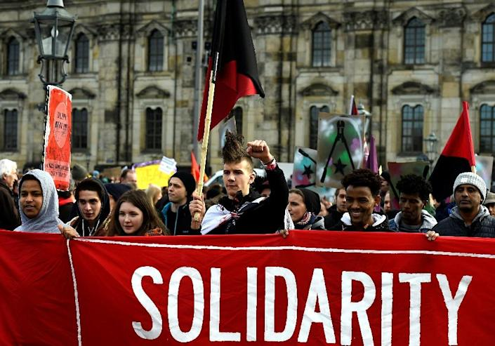 People gather in Dresden on February 6, 2016 to protest against a mass rally of the Pegida movement (Patriotic Europeans Against the Islamisation of the Occident) (AFP Photo/Tobias Schwarz)