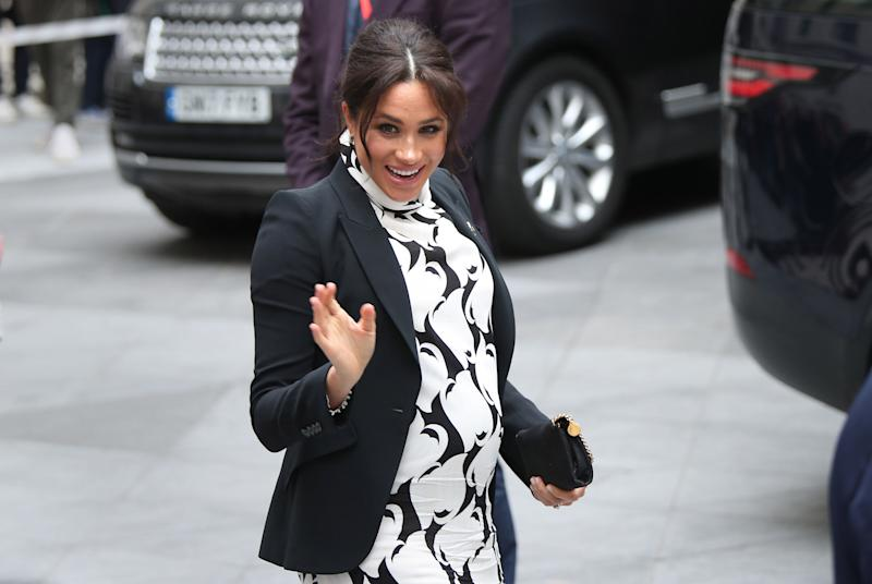 The Duchess of Sussex leaves after a panel discussion convened by The Queen's Commonwealth Trust to mark International Women's Day at King's College in London.