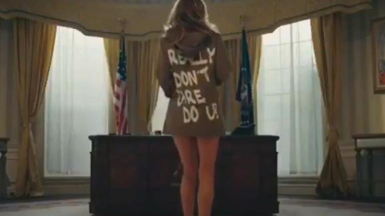 A still from T.I.'s controversial video that shows a Melania Trump look-alike stripping in the Oval Office.