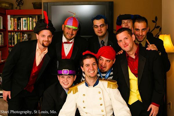 The groomsmen as classic Disney villains: From left to right: Jafar (from Aladin), Tweedle Dee (Alice in Wonderland), Hades (Hercules), Frollo (The Hunchback of Notre Dame), Scar (The Lion King). Second row: Governor Ratcliffe (Pocahontas), Mr. Smee (Captain Hook), Gaston (Beauty and the Beast), and the groom Prince Eric.