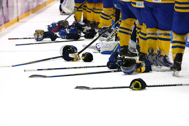 SOCHI, RUSSIA - FEBRUARY 23: The Sweden team line up to receive their silver medals during the Men's Ice Hockey Gold Medal match on Day 16 of the 2014 Sochi Winter Olympics at Bolshoy Ice Dome on February 23, 2014 in Sochi, Russia. (Photo by Martin Rose/Getty Images)