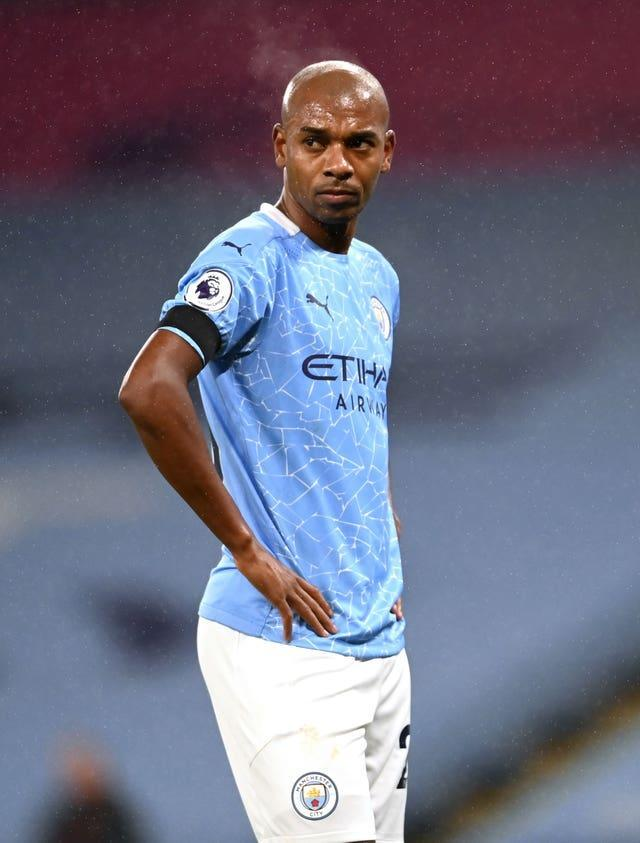 City manager Guardiola (right) has been impressed with Fernandinho (left) this season