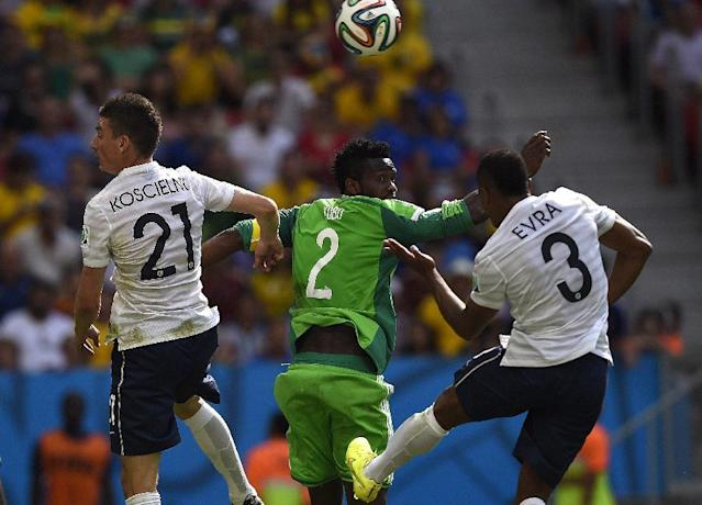 France's defenders Laurent Koscielny (L) and Patrice Evra (R) and Nigeria's Joseph Yobo vie for the ball during a Round of 16 football match at Mane Garrincha National Stadium in Brasilia during the 2014 FIFA World Cup on June 30, 2014 (AFP Photo/Odd Andersen)