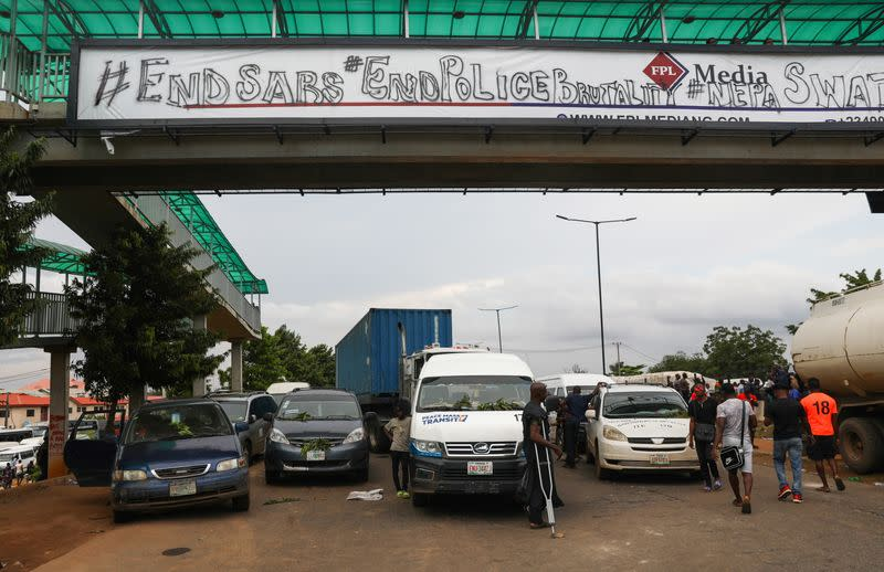 Vehicles are parked on the road due to roadblock in Lagos