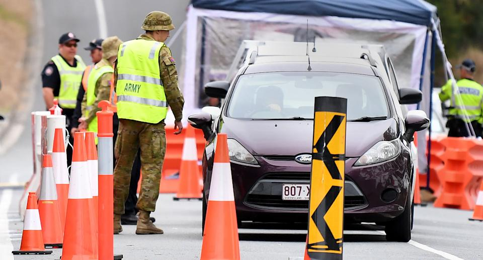 Defence personnel are seen at a checkpoint on the Queensland-New South Wales border in Coolangatta on the Gold Coast. Source: AAP