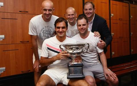 Roger Federer and his agent, Tony Godsick, celebrate his victory at the Australian Open - Credit: getty mages