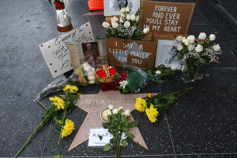 Flowers and tributes are placed on the star for Aretha Franklin on the Hollywood Walk of Fame