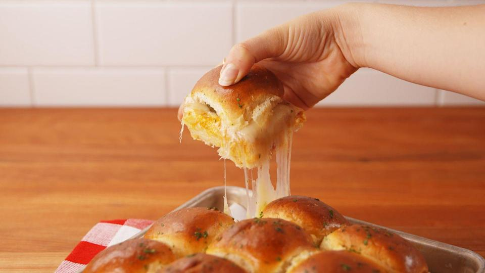 """<p>The Cuban sammy goes bite-sized, with major melted cheesiness and an extra crunch from pickles for the win.</p><p>Get the recipe from <a href=""""https://www.delish.com/cooking/recipe-ideas/recipes/a53730/cheesy-pull-apart-cuban-sliders-recipe/"""" rel=""""nofollow noopener"""" target=""""_blank"""" data-ylk=""""slk:Delish"""" class=""""link rapid-noclick-resp"""">Delish</a>.</p>"""