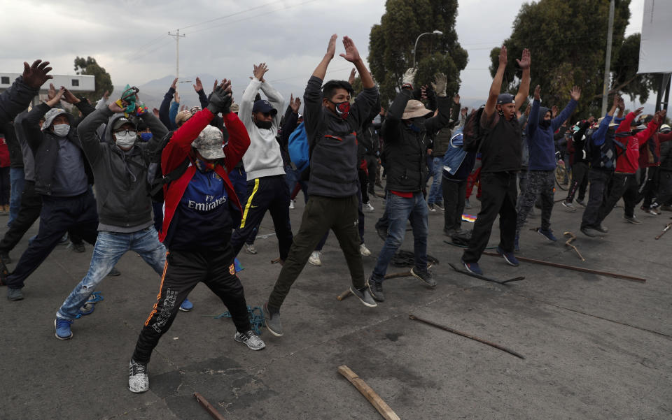 Demonstrators wearing face masks amid the COVID-19 pandemic, protest against the postponement of the presidential election in El Alto, Bolivia, Tuesday, Aug. 11, 2020. Citing the ongoing new coronavirus pandemic, Bolivia's highest electoral authority delayed presidential elections from Sept. 6 to Oct. 18, the third time the vote has been delayed. (AP Photo/Juan Karita)