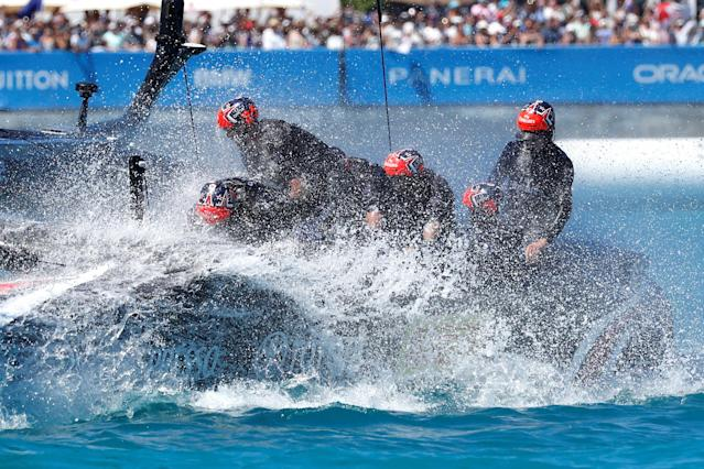 Sailing - America's Cup finals - Hamilton, Bermuda - June 25, 2017 - Team Emirates New Zealand dunks the windward hull after crossing the finish line to win race eight over Oracle Team USA in America's Cup finals . REUTERS/Mike Segar