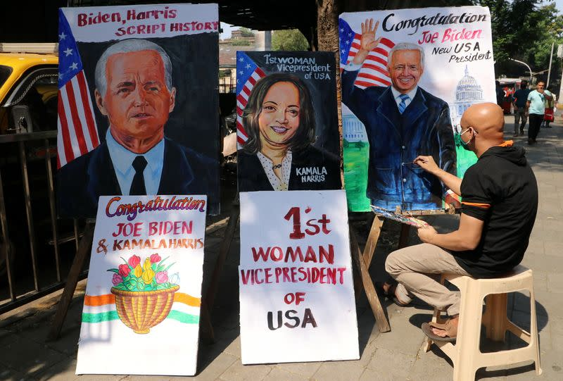 Artist applies finishing touches to painting of U.S. President-elect Joe Biden, in Mumbai