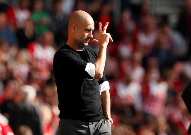 "Soccer Football - Premier League - Southampton vs Manchester City - St Mary's Stadium, Southampton, Britain - May 13, 2018 Manchester City manager Pep Guardiola Action Images via Reuters/John Sibley EDITORIAL USE ONLY. No use with unauthorized audio, video, data, fixture lists, club/league logos or ""live"" services. Online in-match use limited to 75 images, no video emulation. No use in betting, games or single club/league/player publications. Please contact your account representative for further details."