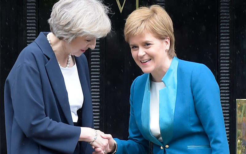 Theresa May and Nicola Sturgeon  - Credit: LESLEY MARTIN/AFP