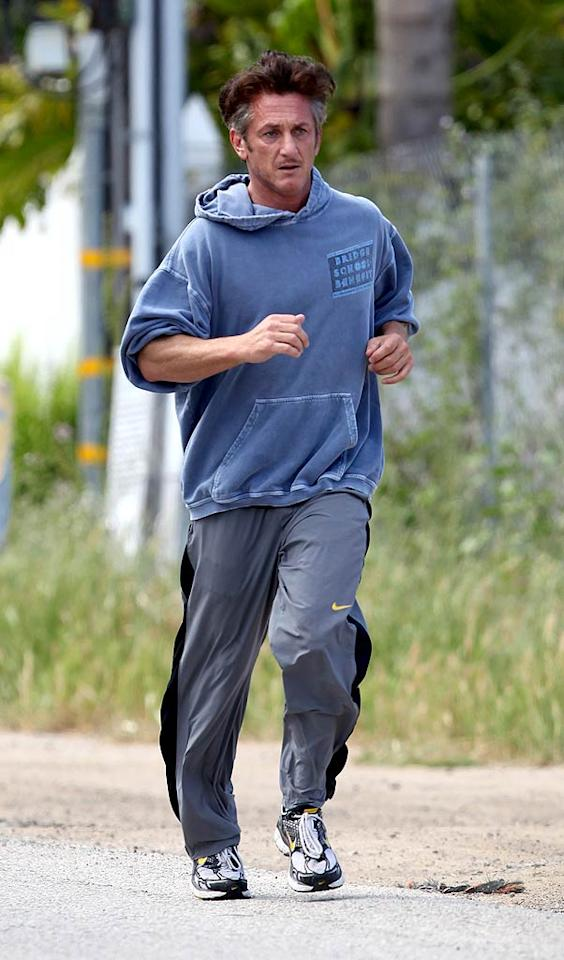 "While Sean Penn used to have a steady jogging partner in girlfriend Scarlett Johansson, he's now back to running solo in Malibu, California. <a href=""http://www.splashnewsonline.com"" target=""new"">Splash News</a> - April 23, 2011"