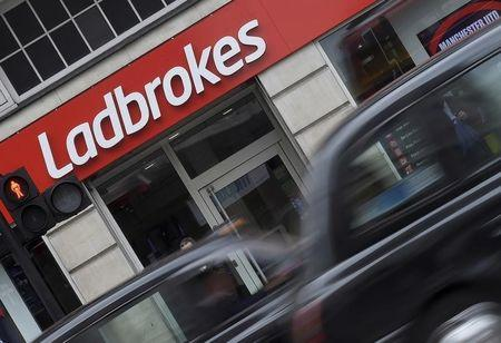 Shaddick, Head of Political Betting at Ladbrokes poses at a branch of Ladbrokes in central London, Britain